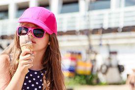 stock photo of gelato  - Kid eating gelato soft serve ice cream - JPG