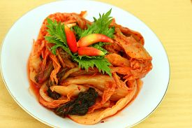 foto of kimchi  - Korean food Kimchi in white plate on wooden table - JPG
