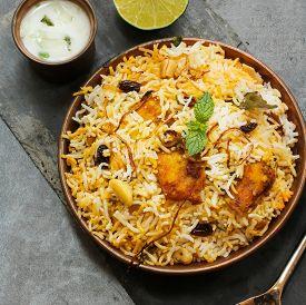 stock photo of raita  - Fish Biryani with raita made with basmati rice - JPG
