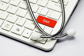 picture of gout  - Gout text stethoscope lying down on the cumputer keyboard - JPG