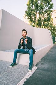 image of bow tie hair  - Young handsome man with short hair wearing a bow tie and posing in the city streets - JPG