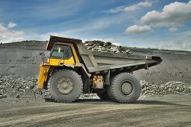 pic of iron ore  - Heavy mining truck loaded with iron ore on the opencast - JPG
