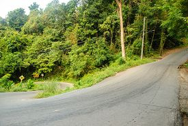 stock photo of twisty  - Very twisty and steep road in the jungle of Koh Chang - JPG