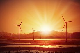 pic of windmills  - Concept of alternative electricity power with windmills on sunset background - JPG