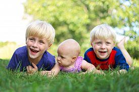 image of three sisters  - Three happy young siblings - JPG