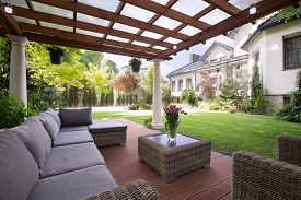 stock photo of canopy roof  - Photo of luxury garden furniture at the patio - JPG