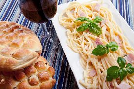 foto of carbonara  - Spaghetti carbonara decorated with fresh basil leaves  - JPG