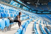 Sexy Girl Posing At Stadium With The Backpack. Fitness Girl With A Sports Figure In Black Leggings S poster