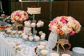 Candy Bar. Delicious Sweet Buffet With Cupcakes And Wedding Cake. Sweet Holiday Buffet With Chocolat poster