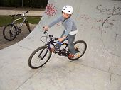 Young Boy With Dirtbike In Halfpipe