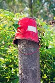 Red Iron Bucket Hanging On Concrete Pillar. Old Rusty Metal Signs In The Chernobyl Zone. Radioactive poster