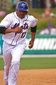 PORT ST. LUCIE, FLORIDA - MARCH 24: New York Mets infielder Fernando Tatis rounds the bases during a