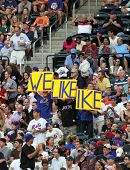 FLUSHING - JUNE 23: New York Mets fans hold signs that read