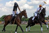 NEW YORK - MAY 30: Argentine polo player Nacho Figueras (L) competes in the Veuve Clicquot Manhattan