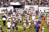 EAST RUTHERFORD, NJ - AUGUST 16: The New York Giants retreat to the locker room at halftime against