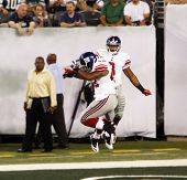 EAST RUTHERFORD, NJ - AUGUST 16: New York Giants wide receiver Victor Cruz and Jerome Johnson celebr