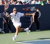FLUSHING, NY - SEPTEMBER 4: Arnaud Clement (FRA) returns a serve during mens singles at the US Open Tennis Tournament at Billie Jean King National Tennis Center on September 4, 2010 in Flushing, NY.