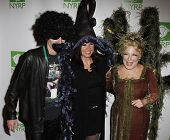 NEW YORK - OCTOBER 29: John McEnroe, Patty Smyth and Bette Midler attend the 15th Annual New York Restoration Project's Hulaween at the Waldorf-Astoria Hotel on October 29, 2010 in New York City.