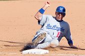 SCOTTSDALE, AZ - MARCH 7: Los Angeles Dodgers catcher A. J. Ellis slides into third base in a spring