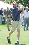 ORLANDO, FL - MARCH 23: Jay DeMarcus of Rascal Flatts tees off during a practice round at the Arnold