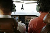foto of cessna  - Pilot and passenger in cockpit of small plane - JPG