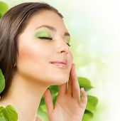 Spring Beauty outdoors applying the natural cosmetics. Perfect skin
