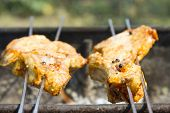 Постер, плакат: The Shish Kebab From Meat Prepares On Charcoal Pieces Of Meat Are On Skewers