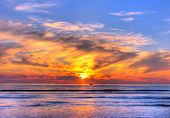 stock photo of sunset beach  - Sunset on the beach orange blue red - JPG