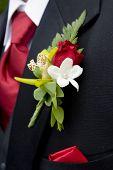Alfiler Flor del hombre con corbata roja