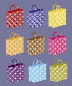 variedade de sacos de compras com padrão
