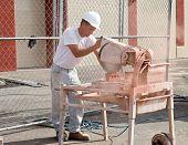 Construction Worker Custom-cutting Brick