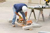 Worker Sawing Metal Studs