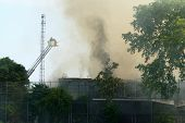DAYTON, OHIO - AUGUST 15: Firefighters battle an old, abandoned warehouse fire through billowing smoke on August 15, 2008 in Dayton, Ohio, USA.