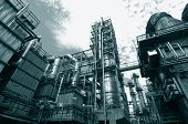 stock photo of duplex  - oil and gas refinery in a dark duplex toning idea - JPG
