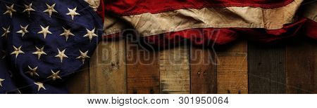poster of Vintage red, white, and blue American flag for Memorial day or Veteran's day background