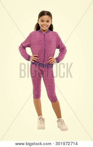 poster of Deal With Long Hair While Exercising. Girl Cute Kid With Long Ponytails Wear Sportive Costume Isolat