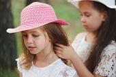 Girl Braids Her Friends Braid In Park poster