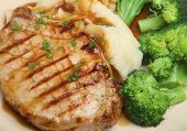 Pork loin steak with mashed potato and broccoli