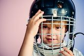 Sport Childhood. Future Sport Star. Sport Upbringing And Career. Boy Cute Child Wear Hockey Helmet C poster