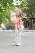 Kid Long Hair Enjoy Walking. Summer Holidays. Little Child Enjoy Walk. Health, Good Mood And Positiv poster