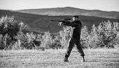 Hunter With Rifle Looking For Animal. Hunting Shooting Trophy. Man Rifle For Hunt. Mental Preparatio poster