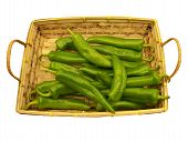 picture of chili peppers  - Hot green chili peppers in a basket on white background - JPG