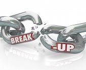 Two metal chain links broken with the words Break-Up to represent a separation or divorce, or the en