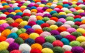 Multicolored felt ball rug detail, colorful texture poster