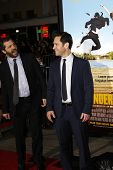 LOS ANGELES, CA - FEB 16: Paul Rudd; Judd Apatow at the premiere of Universal Pictures' 'Wanderlust'