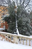 Renaissance street light under snow