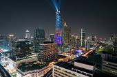 Night View With Skyscraper In Business District In Bangkok Thailand. Light Show At Magnolias Ratchap poster