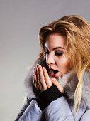 Seasonal Fashion, Clothes And Clothing Concept. Woman Wearing Light Winter Warm Furry Coat Feeling V poster