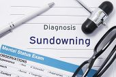 Diagnosis Sundowning. Medical Note Surrounded By Neurologic Hammer, Mental Status Exam With An Inscr poster
