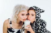 Milk Your Diet. Adorable Women Having A Healthy Diet. Pretty Girls On Dairy Diet Drinking Milk Toget poster